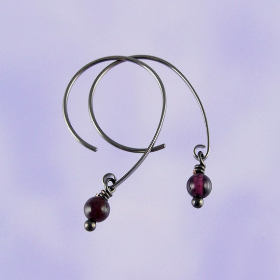 Niobium earrings: Garnet beads on Apostrophe earwires