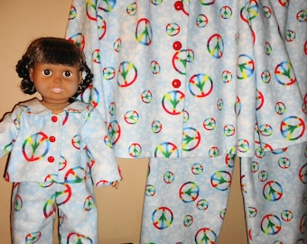 "Girl and doll matching flannel pajamas, blue with rainbow peace signs, girl size 6, 18"" doll"
