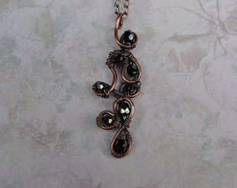Antiqued Copper Pendant With Green Crystals