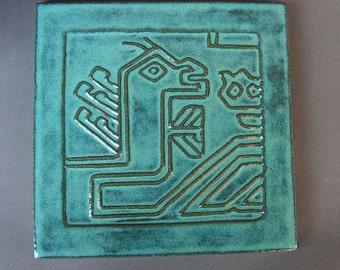 Blue stoneware trivet with 15th century Anatolian rug design