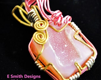 Pink drusy wirewrapped in gold tone and pink and silver pendant
