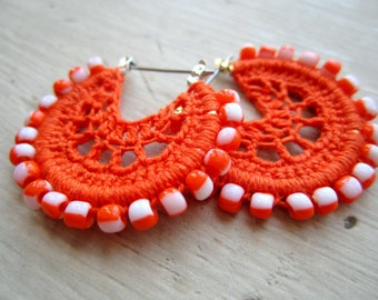 Crocheted hoops with beads in orange