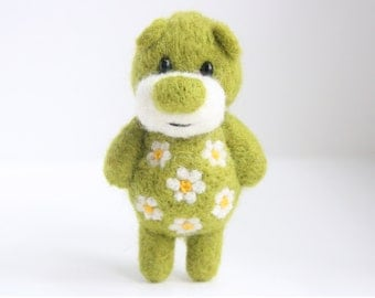 Green felted bear with a blossoming belly