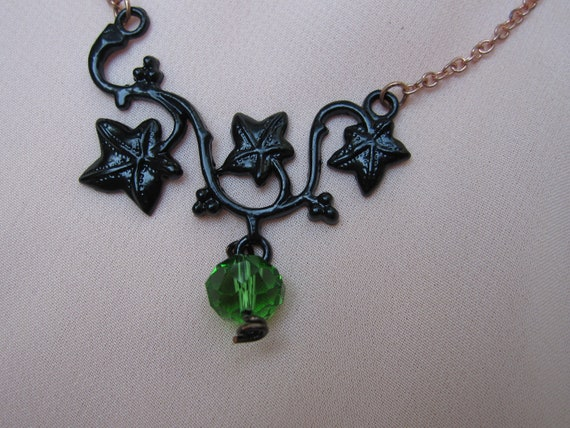 Beautiful black metal leaf vine 8mm green glass crystal embellishment with copper tone chain necklace.
