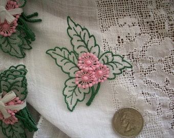Antique raised pink flowers with leaves in a hand loomed appliqué