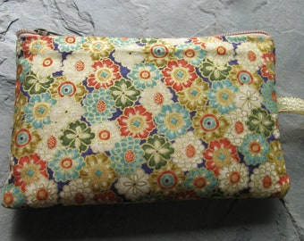 padded makeup jewelry bag in all over flower print