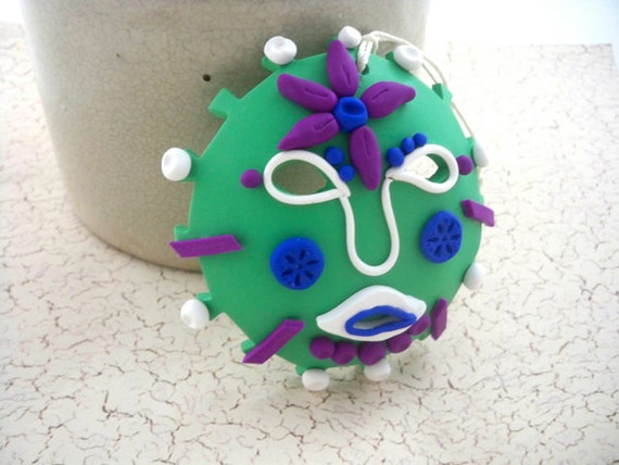 Sun mask ornament colorful Mexican inspired polymer clay green and magenta primitive