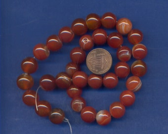 """16"""" Strand of 12mm Red Agate  Beads"""