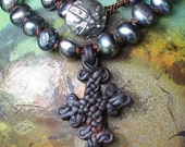 HALF PRICE -leather on pearls necklace...