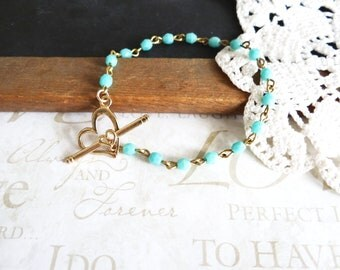 LOVEABLE in turquoise beaded toggle bracelet with heart toggle closure (gold)