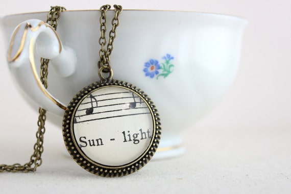 Sun necklace made with vintage sheet music.  Vintage style jewelry with toggle clasp for women