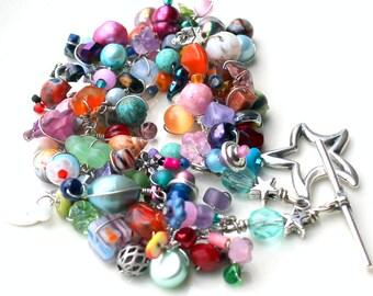 star bracelet. soft colors. rainbow colors handmade beaded wire wrapped layering gemstone bracelet. costume jewelry