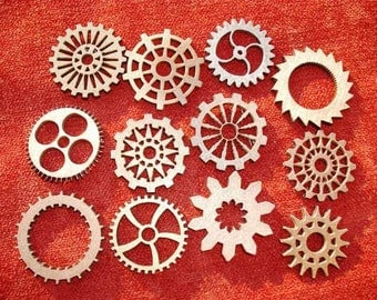 "Grouping Of 12 Small Wood Laser Cut Gears - Size F  1' - 1.5"""", Metal Color - Copper, Brass, Bronze"