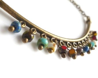 Boho Beaded Necklace - fun Bohemian style bronze pendant with tiny colorful bead fringe on antique brass chain