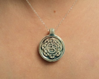 Om lotus flower necklace.  Raku pottery.  Sterling silver chain.  Yoga.  Buddhism. Hinduism.  Metaphysical.