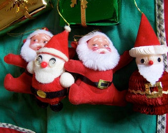 four santa's and two tiny gift packages
