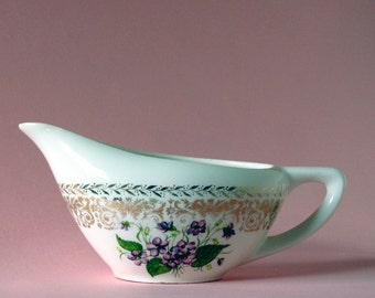 Gravy boat with fancy gold border and pretty purple violets may be Springviolet distributed by Cunningham & Pickett Inc of Alliance Ohio