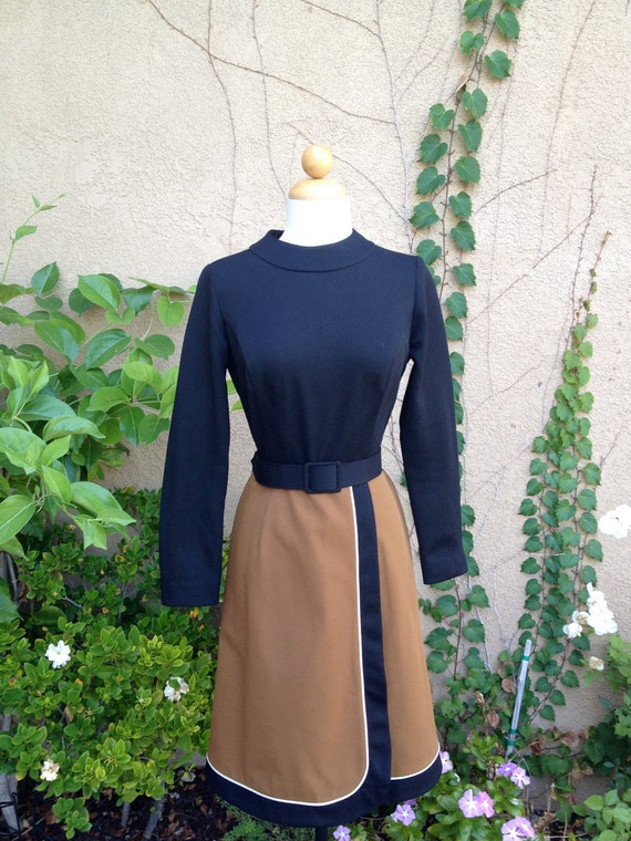 A vintage 1960s 1970s black and brown long sleeves high collar retro dress size S M