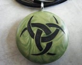 Triple godess hand carved on a polymer clay olive green pearl color background.  Pendant comes with a FREE 3mm necklace