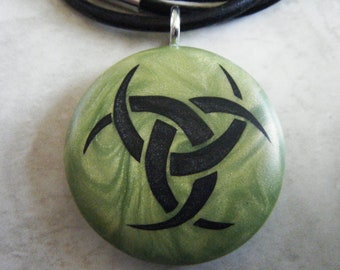 Triple godess hand carved on a polymer clay olive green pearl color background.  Pendant comes with a FREE necklace