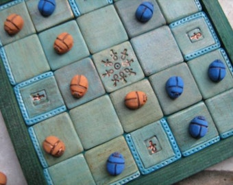 Ancient Egyptian Seega Game Board in turquoise and green shade with 12-12  Scarab pawns in textile bag
