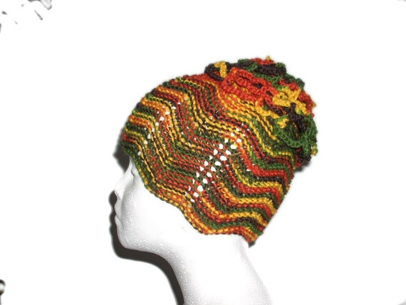 Hand knitted yellow red green brown fall colours  hat and flower brooch