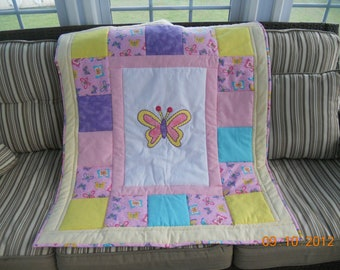 Baby quilts with giraffes, butterflies, elephants, bears, all customized