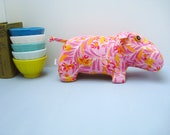 Pink and yellow plush hippo