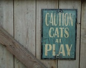 Wooden sign Caution cats at play sign made from reclaimed plywood