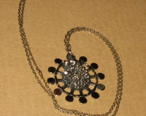 MODERNIST PENTTI SARPANEVA bronze pendant with floral motif Finland
