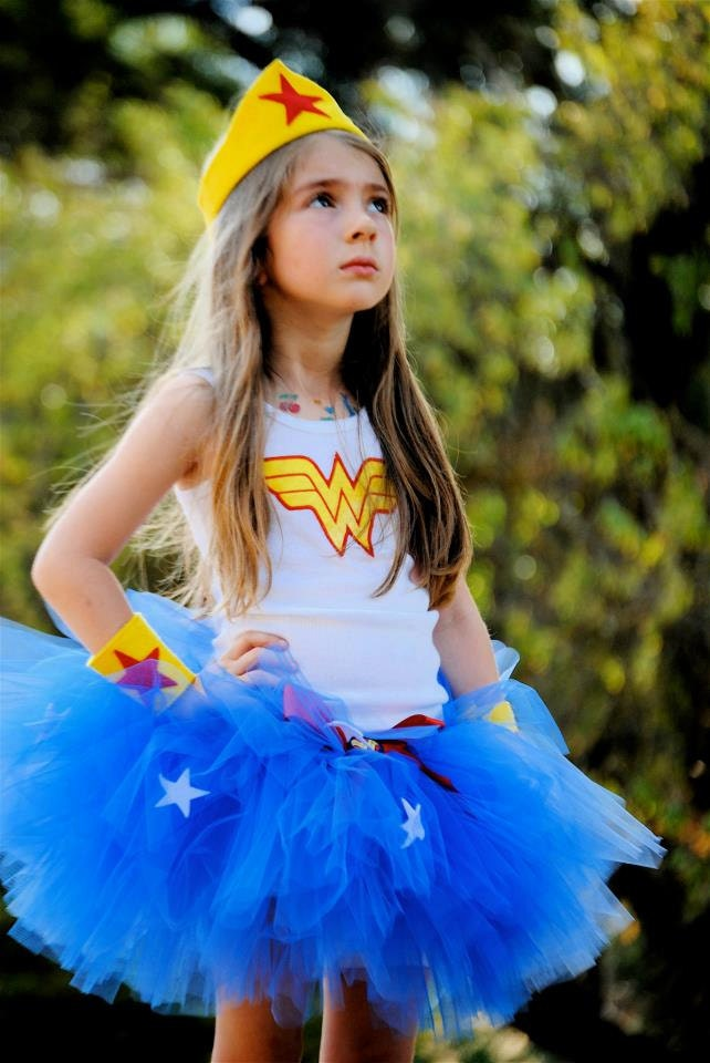 Better put on your Girl's Wonder Woman Tutu Costume and find it again! This dress falls to the mid-thigh and has a sleeveless design. The red lame bodice is decorated with your yellow logo, glitter helping it .