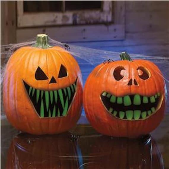 6 packs  of Glow in the dark Pumpkin Teeth. 1 pack of ea Size