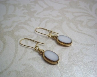 White German Vintage Beads from the 1950's Surrounded by 24K Gold Earrings