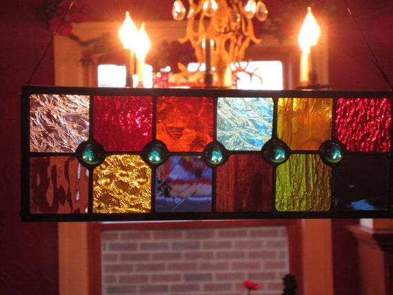 Stained glass suncatcher brilliantly colored with a flair of teal glass gems THINK CHRISTMAS GIFT