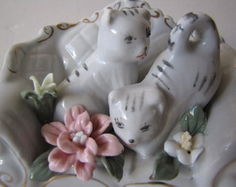 Sweet Tabby Cats Posing on a Ceramic Sofa