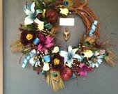 Peacock Lily Feathers Daisy Poppies Foliage and Grapevine Wreath