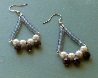 Beaded Chandelier Earrings with glass beads glass pearls, and Czech crystals in gray, black and white hanging from a french ear wire