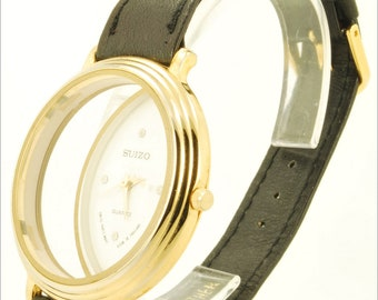 Suizo vintage quartz wrist watch, oversized gold-toned round skeletonized case, crystal hour markers on dial