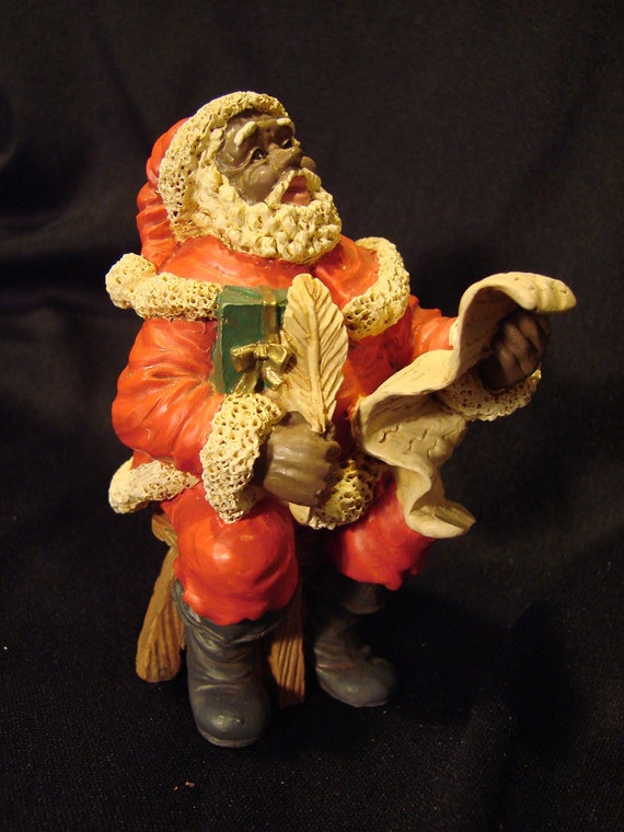 Black santa claus figurine with good girls and by