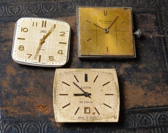 Set of 3  Vintage watch movements, watch parts, watch faces.