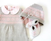 A knitted baby dress, cap and socks in gray/pink with jacquard. 100% wool. Newborn.