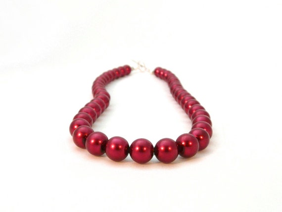 ruby red pearl necklace with swarovski crystals and sterling silver. metallic.