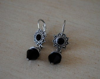 vintage jewelry. beautiful black beads and silver metal earrings.