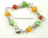 Silver Bracelet of Green, Orange & Red Lampwork Beads