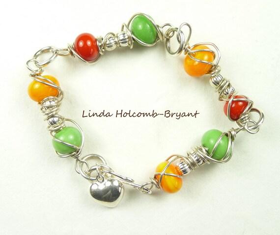 Silver Bracelet of Green, Orange & Red Lampwork Beads
