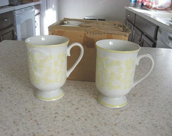 Set of four Holt Howard mugs new in original box
