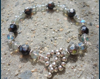 Ayla's Bead Creations black ab silver accented 7 1/2 Inch toggle clasp Bracelet can be adjusted to 8 1/2.