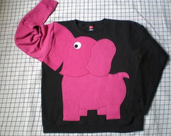 Bright pink elephant on black sweatshirt. Elephant trunk sleeve shirt. Elephant shirt. Adult unisex sizes.