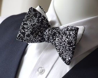 Men's Bow Tie - freestyle mens bowtie, black and white floral fabric with white linen on reverse. Bagzetoile -  makers of mens bowties.