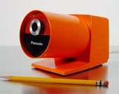 Midcentury Modern Orange Electric Pencil Sharpener by Panasonic, model KP-22A Pana-Point Pencil Sharpener from Panasonic, 1970s.